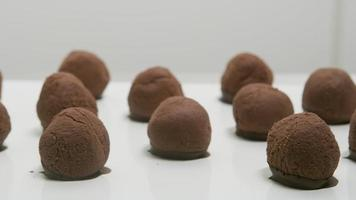 Chocolate truffles on a conveyor belt at candy factory video