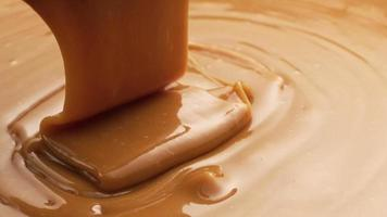 Pouring melted caramel, closeup food shot. video