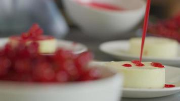 Cheesecake is topped with berry sauce video