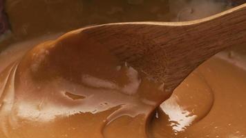 Stirring melted caramel, closeup food shot. video