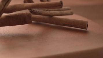 Cinnamon Sticks falling onto wooden surface in super slow motion.  Shot on Phantom Flex 4K high speed camera. video