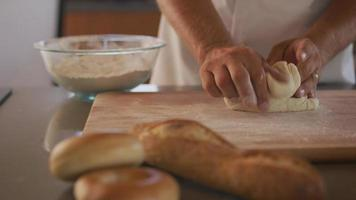 Chef kneading bread dough at bakery video