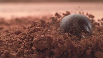 Chocolate truffles falling into chocolate powder in super slow motion.  Shot on Phantom Flex 4K high speed camera. video