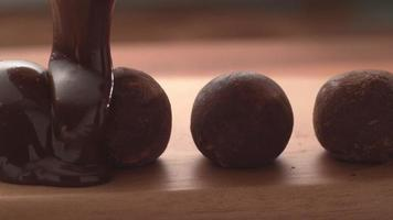 Chocolate pouring onto truffles in super slow motion.  Shot on Phantom Flex 4K high speed camera. video