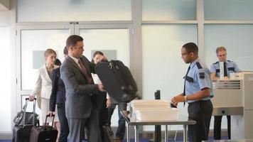 Group of business people at airport security checkpoint video