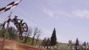 Motocross racers going around corner 4K fully released video
