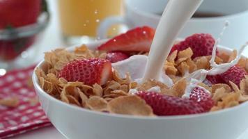 Milk pouring into cereal bowl in slow motion shot on Phantom Flex 4K at 1000 fps video