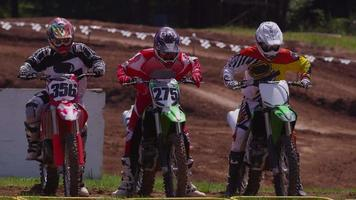 Motocross racers going over bumps 4K fully released video
