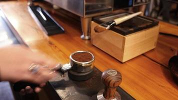 Woman making coffee at cafe video