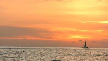 Sailboat on the ocean at sunset video