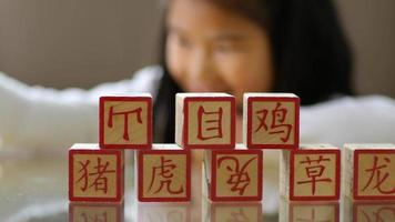 Young girl stacking Chinese blocks video