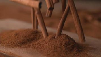 Cinnamon sticks falling into powdered cinnamon in super slow motion, shot on Phantom Flex 4K video