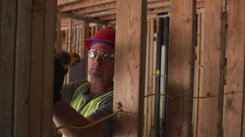Construction worker using screw gun video