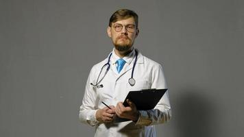 Doctor in White Coat Taking Notes video