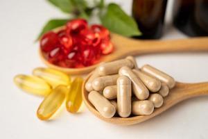 Alternative medicine herbal organic capsule with vitamin E omega 3 fish oil photo
