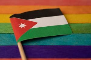 Jordan flag on rainbow background symbol of LGBT gay pride month photo