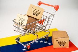 Box with shopping cart logo and venezuela flag photo