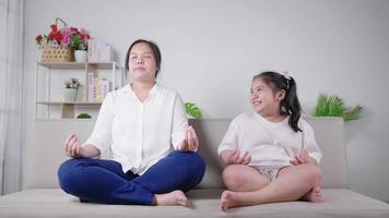 Mom and kid having meditation activity on the weekend together Kid laughing mom Quarantine and stay safe concept during Covid situation video