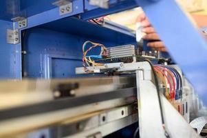 Technician repairing mainboard of colors dispensers of inkjet printer photo