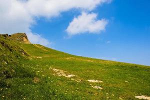 Green hill and sky photo