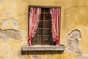 Old window with curtains photo