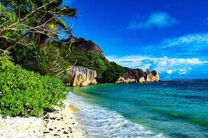 Tropical beach and mountains photo