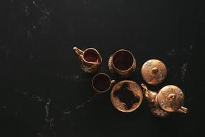Luxurious tea equipment in red and gold photo
