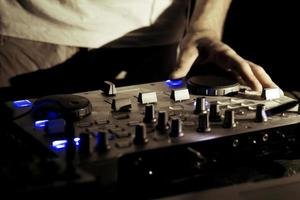 DJ mixing on the turntable photo