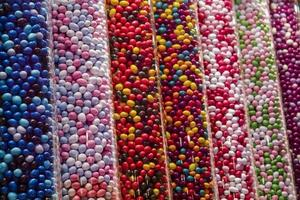 Colorful candies in tubes photo