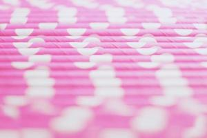 An amazing and beautiful macro with a depth of field about pink straws with polka dots photo
