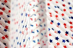 An amazing and beautiful macro with depth of field and space about white straws with blue and red stars that seems like United States flag photo