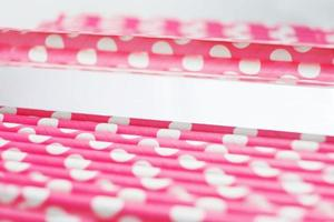 An amazing and beautiful macro with depth of field and space about pink straws with polka dots photo