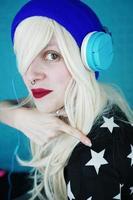 Beautiful blonde woman listening to music photo