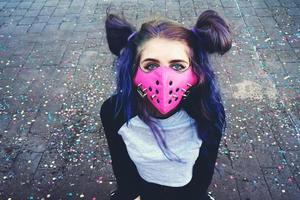 Young punk woman wearing a pink mask photo
