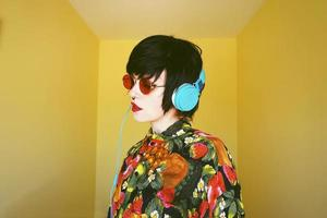 Cool androgynous dj woman in vibrant colors photo