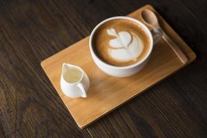 Hot latte art on wood table photo