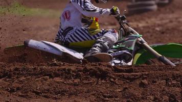 Motocross racer makes dirt fly in slow motion 4K fully released video