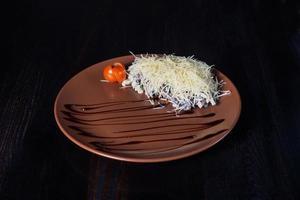 warm roast beef salad on a plate, beautiful serving, dark background photo