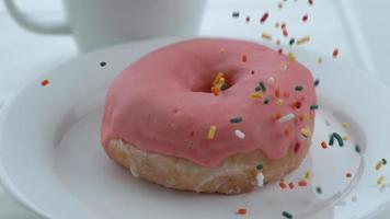 Sprinkles falling onto donut in slow motion shot on Phantom Flex 4K at 1000 fps video