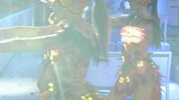 Close of Women Dancing with Bright Lights video