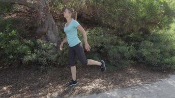 A young woman runner stretching before her run video