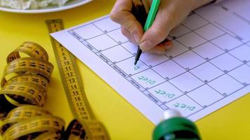 A Close up of a Food Calendar Being Filled video