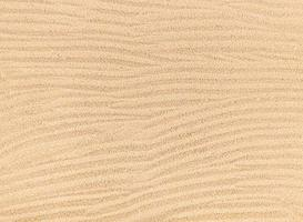 Sand waves texture background, beach top view. photo