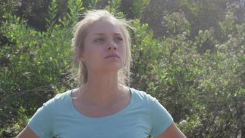 A young woman runner resting after jogging. video