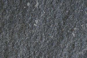 Textura de piedra negra con grietas y astillas, imagen de fondo foto