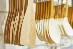 Shop window with wooden kitchen utensils. photo