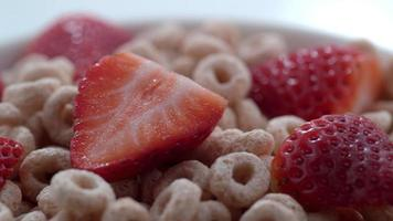 Closeup of milk pouring onto bowl of cereal with strawberries shot on Phantom Flex 4K at 1000 fps video