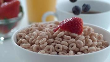 Berries dropping into cereal in slow motion shot on Phantom Flex 4K at 1000 fps video