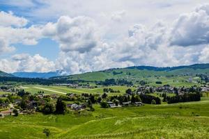 Grassland, clouds, and mountains photo