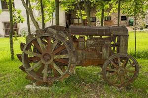 Antique rusty tractor photo